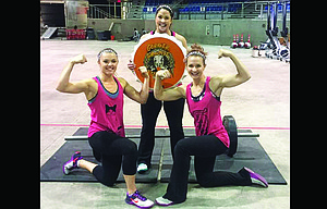 CrossFit participants, pictured from left to right, Cassidy Tibbets, Vicki Renner and Hailey Elliott flexed their muscles this past weekend in Salem at the Gobbler Gauntlet, scoring first-place honors. In the final relay, the local trio had a final time of three minutes and 58 seconds, besting their next opponent by two seconds to clinch first.                                                      Contributed photo