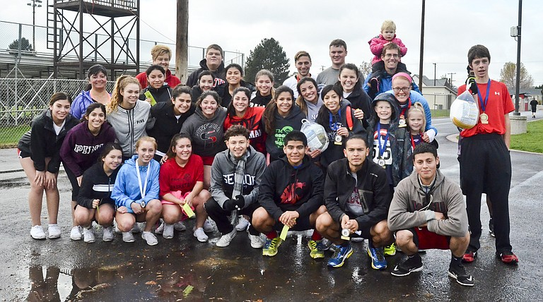 Turkey Trot participants and organizers gather for a photo opportunity.