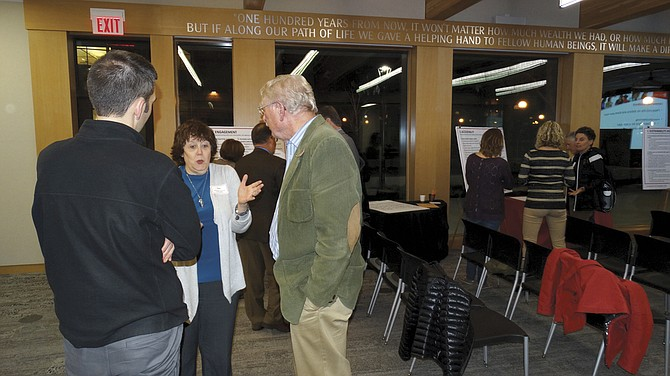 Cec Koontz, middle, speaks with Marshall Guthrie, left, and Paul Sieber, right, about WOU's goals. Koontz and Guthrie are both on the Western Oregon University board of trustees, as well as on the strategic planning committee.