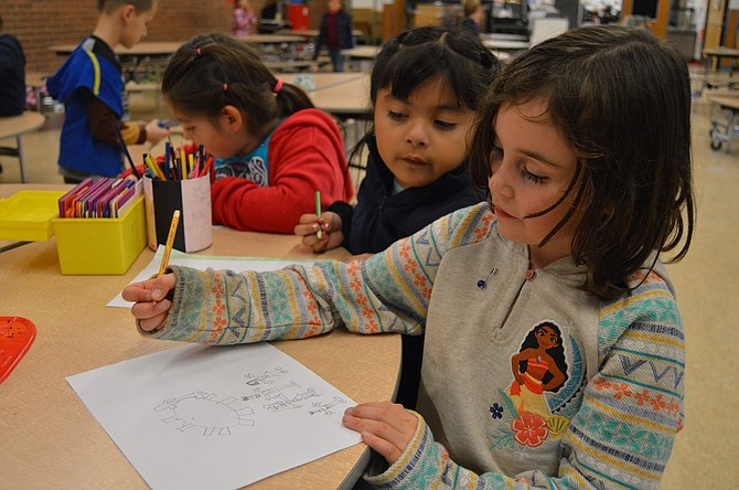 """In the American tradition, our communal gratitude is manifest in the Thanksgiving holiday meal: abundance such as """"tuekey and masht ptaytows,"""" """"mufens"""" and """"pumcan pie.""""Vanessa Quintana takes a look at what fellow Mid Valley Elementary student Aya Yasui is drawing — see below for Aya's completed work."""