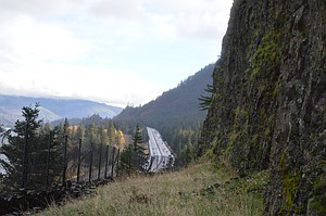 Interstate 84, looking east, below the rocky heights at Mitchell Point, where a retaining fence separates the ledge. New grant for ODOT elevates the agency's ability to pursue the long-term goal of restoring the Historic Columbia River Highway Trail through the Gorge.