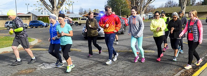 About 15 runners start Friday's fundraising run in support of Mike Akins, organizer of the annual Sage Rat Run.