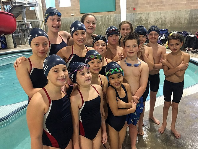 THE OSPREY swimmers pose for a group photo after having a great showing at the Fall Chinook Open in Astoria last weekend.