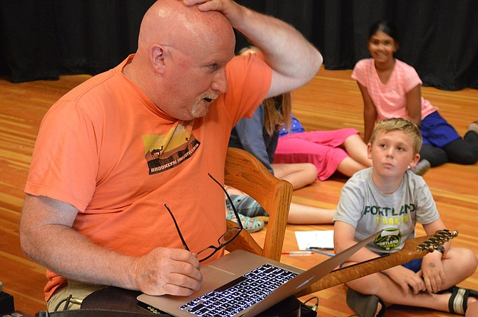 "TIM Ellis uses his bald head to make a musical point in this July 2015 photo taken while teaching kids music along with Aaron Meyer in Hood River through Community Education. ""We were a good team that was what he was all about: making things work, with quality,"" Meyer said. ""He loved musical education as much as I did. He loved challenging kids to be responsible musicians, learning about math and science through music."""