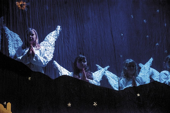 Children sing as the angel choir of heaven during the final performance of Rickreall Christmas Pageant last year.