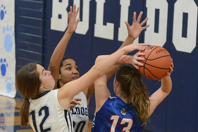 Grangeville guard Kate Lutz (12) and post Jakaili Norman were all over McCall on this trap in the corner -- much as the Bulldogs were all over the floor all night during their 54-30 win over the Vandals Friday, Dec. 2.