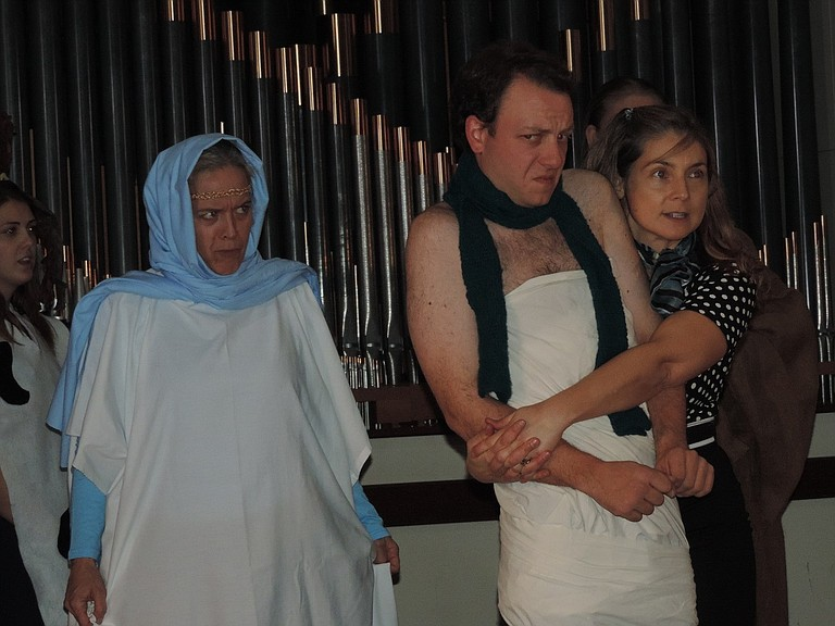MARY Beth Baird aka the Virgin Mary (Kim Robichaud) glares fiercely at Barb Wiggin (Jennifer Hanlon Wilde) as she embraces a tightly-swaddled Owen Meany (Jimmie Oates) during the climactic pageant scene.