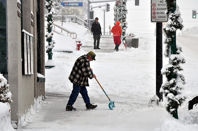 Snow shoveling along Main Street in Grangeville. (Free Press Archive)