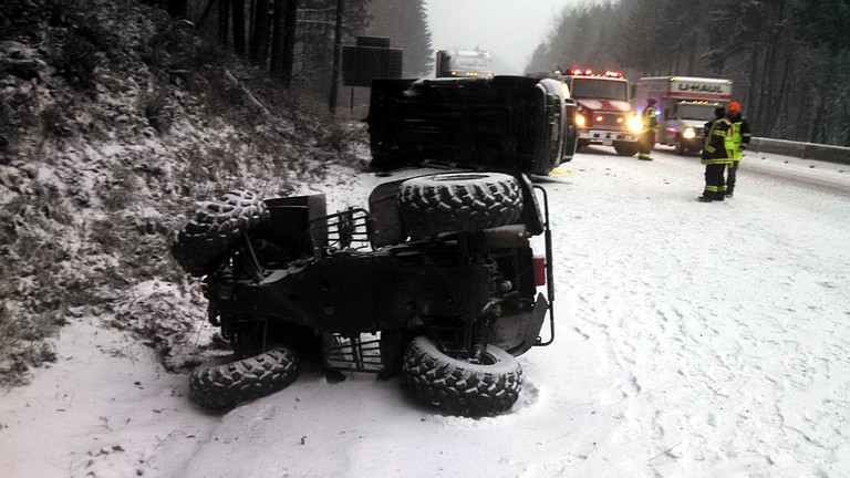 CRASH on Interstate 84 in western Hood River County took the life of a 70-year-old man from Stevenson. The accident came amid a snow storm that hit the Gorge Thursday. Above, a four-wheeler fell from the single pickup truck involved in the crash.