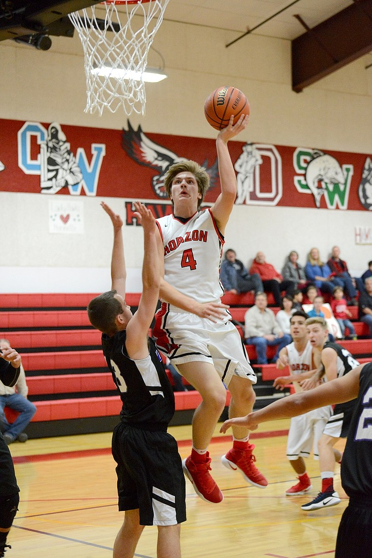 DEREK JOHNSTON drives to the hoop during Tuesday's game with Life Christian.