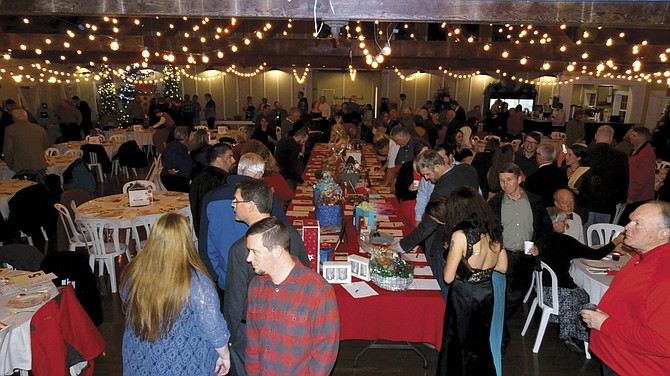 The 17th annual YMCA Christmas Party and Auction was sold out, attended by 200 people.