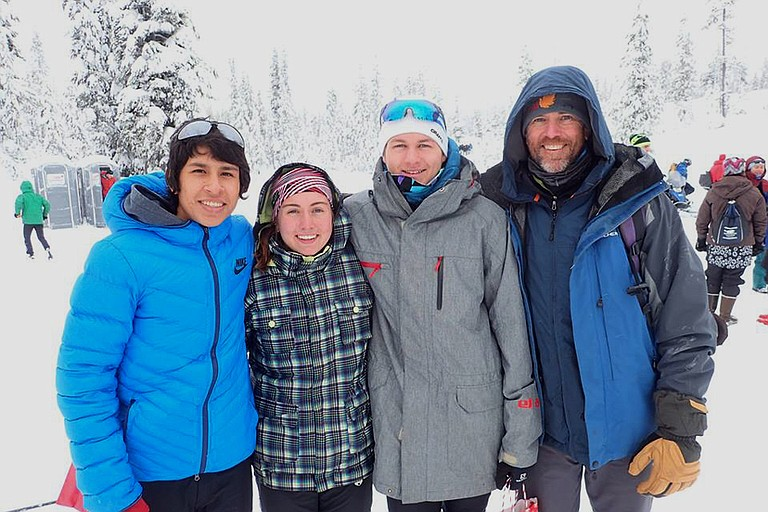 HRV NORDIC got off to a great start and was the only Eagles team late last week attending a competition that actually benefited from the snowfall that the region experienced. Elkin Parker (far left), who also reached the podium in the boys race with a sixth-place finish, poses for a photo with Daisy Dolan, Leif Bergstrom, and Coach Joe Dolan.