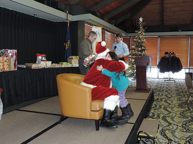 Alexia Aguilar, a Westside Elementary kindergartener, hugs Santa Claus Thursday during the annual Hood River Rotary holiday luncheon in the Gorge Room at Best Western Plus Hood River Inn.