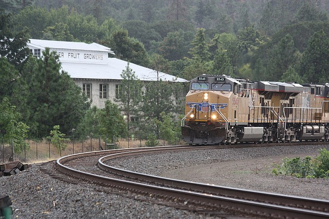 An eastbound Union Pacific freight train rolls through Mosier, where the railroad proposes to build about four miles of second mainline track.