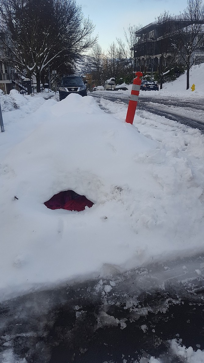 SNOW cave, one of several found dangerously close or within city rights-of-way. Parents should ensure children build snow structures out of the way of cars.
