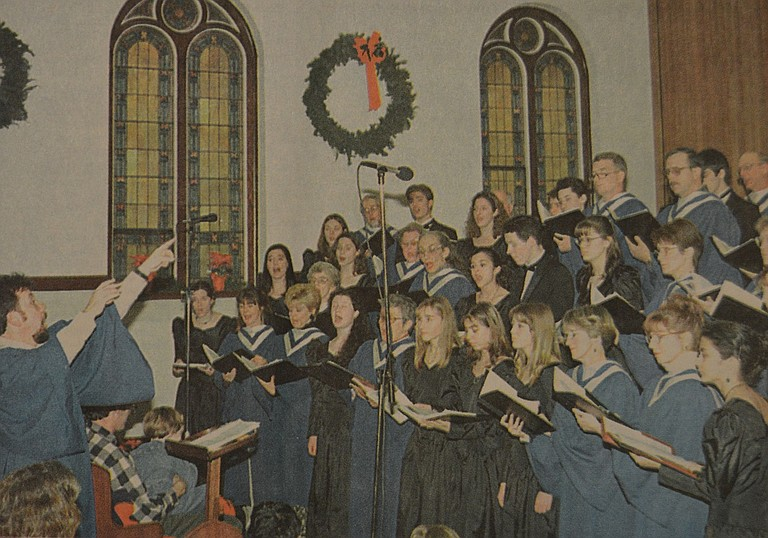 December 25, 1996: An estimated crowd of 175 persons packed Riverside Community Church on Friday, Dec. 20, for a noon concert performed by the combined church and Hood River Valley High School choirs. The concert choir and treble choir from the high school performed a number of Christmas selections in addition to melding their voices for several combined numbers with the church group, directed by Mark Steighner. Jim Kelly photo.