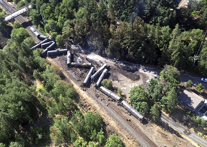 AERIAL PHOTO shows scattered, burned oil tank cars after a derailment in Mosier, which prompted railway operational changes.
