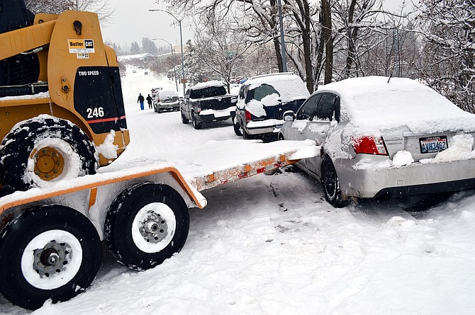 TRAILER spun out and hit a parked car Monday on Wasco Street, one of many crashes throughout the Gorge during snowy weather.