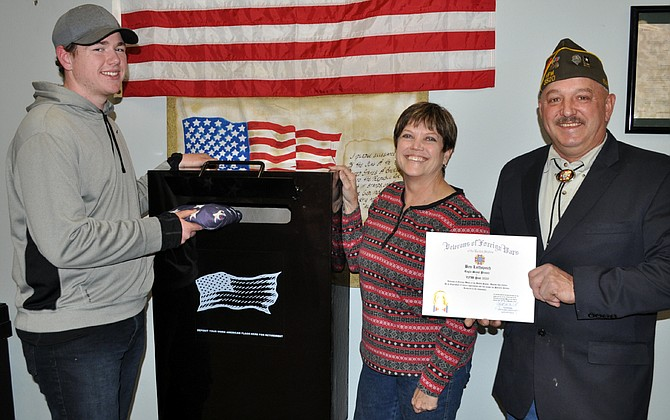 A new collection receptacle for damaged, worn and faded U.S. flags is available to the public at the Veterans Outreach and Community Center in Grangeville. The box was created as part of an Eagle Scout project by Ben Lothspeich (left), pictured here with veterans' center coordinator Jinny Cash, and Chad Miller, commander of Grangeville VFW Post 3520.