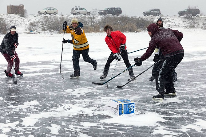 Continued sub-freezing temperatures turned the Hook at the Hood River Waterfront into a makeshift hockey rink, and these folks (above) laced up their skates and grabbed some sticks for an impromptu ice hockey game (or shinny, technically, if you want to get Canadian about it).