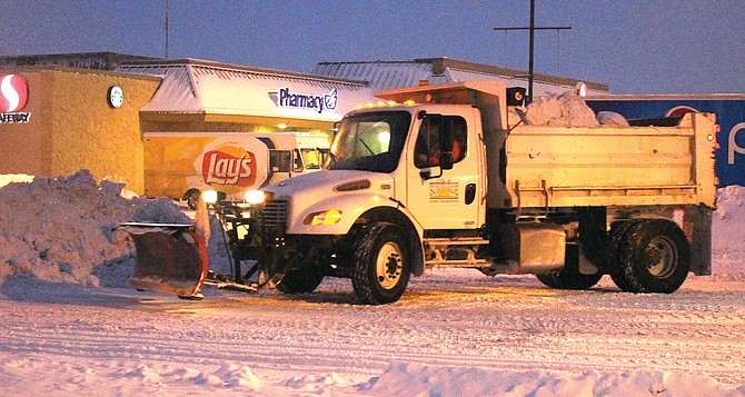 A city of Sunnyside truck removes snow from downtown's Grant Avenue.