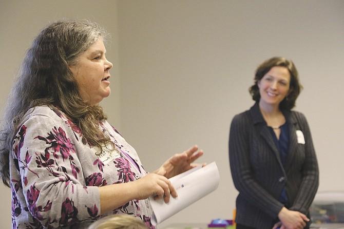 Monmouth Library Director Krist Obrist, left, speaks on Jan. 10.