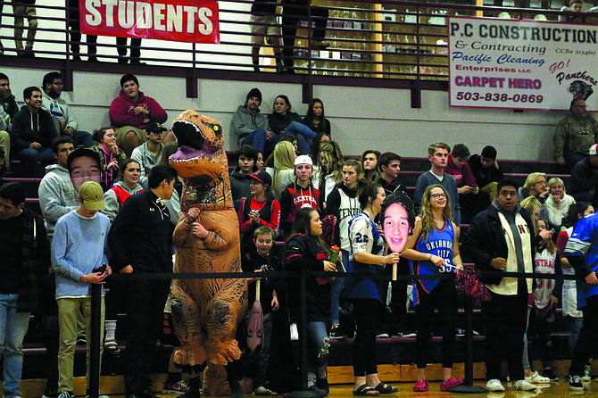 Some Central fans showed school spirit by going a little prehistoric when rooting for the Panthers' boys basketball team on Friday. Central lost to Crescent Valley 61-47. The Panthers host Lebanon Wednesday (today) at 7 p.m. and Dallas Friday at 7 p.m.