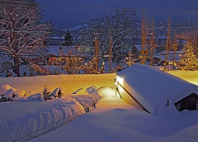 """For our centerpiece, Darryl Lloyd provides photo and message, from last Wednesday: """"Outside it's 22 degrees and there's two feet of fresh powder snow on the ground. In the background is the Columbia River and lights of White Salmon on the right. I rigged a climbing rope along my walkway, which is steeper than it looks. Happy mid-winter, wherever you are!"""""""