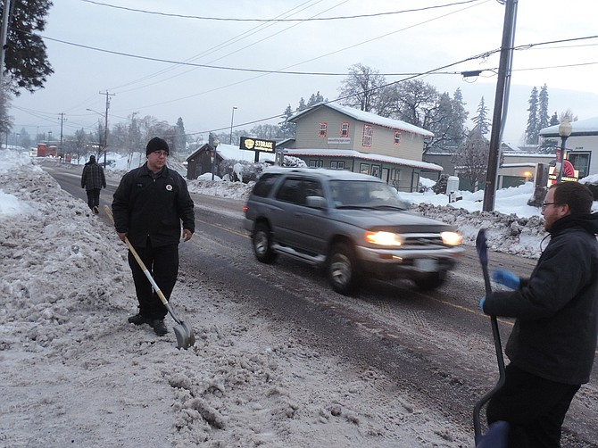 As the thaw gradually happens, digging out the thoroughfares is increasingly a job for businesses and agencies this week. After ODOT plowed West Cascade Tuesday, Alan Eaton, right, and Billy Williams of Oil Can Henry's chop and shovel away the hard-crusted debris filling the entrance.