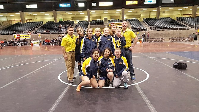 HRV GIRLS WRESTLING athletes and coaching staff pose with their first-place trophy from the Oregon Classic.