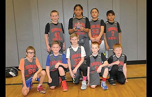 Fifth-grade players representing the Columbia Gorge Basketball Academy went 4-0 and outscored opponents by a 192-43 margin this past Sunday in a hoops tournament at The Dalles Middle School. The players are, pictured from left to right, starting on top, Nolan Donivan, Andre Niko, Henry Begay and Olsen Meanus. On the bottom are, from left, J.J. Johnston, Tristan KuKu, Cooper Cummings, Calvin Floyd and Sam Shaver. Not pictured is head coach Greg Cummings. In the title game against Hood River Valley,  Niko, Cummings and Begay combined for 33 points in a 51-8 win.