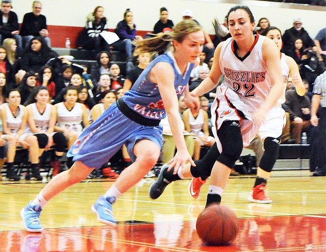 Jessica Mendoza of the Grizzlies defends against West Valley's Shannon Curtis before stealing the ball.