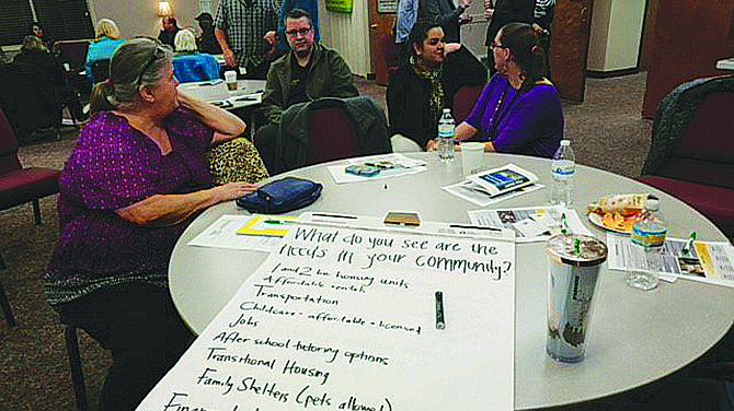 Attendees at the community homelessness forum on Thursday learned about the resources available in Polk County and shared ideas about how the community can help.
