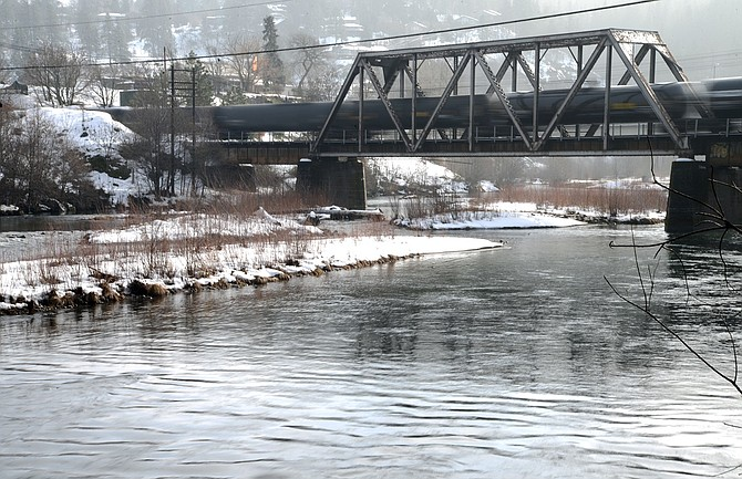 A train passes above the Hood River near the pedestrian bridge by History Museum of Hood River County Thursday. Regulators are keeping an eye on local waterways for pollutants, according to a new series of proposed listings, which include parts of the Hood River and Columbia.