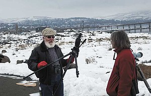 Ralph Thomas Rogers of Goldendale, at left, talks with presenter Catherine Flick with Friends of the Columbia Gorge during an eagle watch Sunday at The Dalles Dam Visitor Center. Rogers also attended the eagle watch sponsored by the Corp of Engineers at the center on Saturday, and said it was a full house for that program, with an abundance of both eagles and visitors. The Friends frequently hold weekend eagle watches at the site.