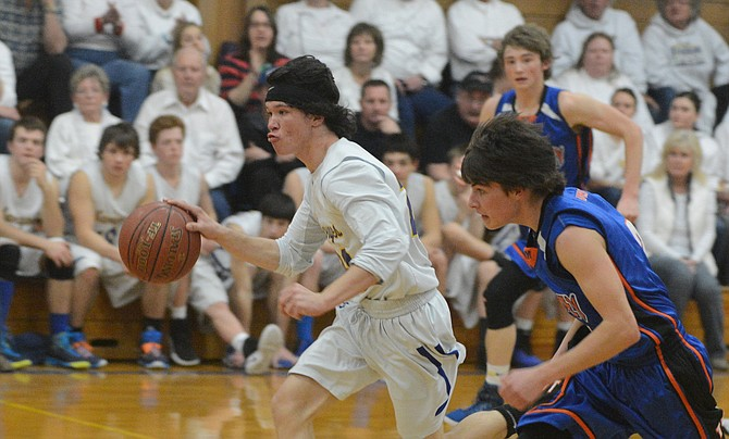 Salmon River senior Tucker Boyd races ahead with a steal during the Savages' narrow win over Tri Valley Jan. 28.