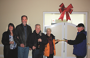 """Many of the """"major movers"""" in getting the Civic Auditorium's ballroom kitchen rebuilt and upgraded  celebrated on Monday with champagne and a ribbon cutting. Pictured are, left to right, Beverly and Patrick Erickson, Ross Bailey, Nancy Fath, and Jerry McKay."""