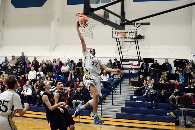 AIR TACTAY: Jonah Tactay comes close to a dunk, but settles for a layup during Tuesday's game against The Dalles. Tactay came off the bench with 20 points on 9-for-12 shooting from the field, hitting some crucial field goals in the 66-63 win.