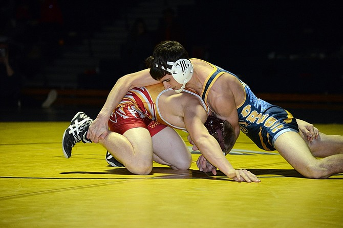 CADE PARKER wrestles in Thursday's match with The Dalles.