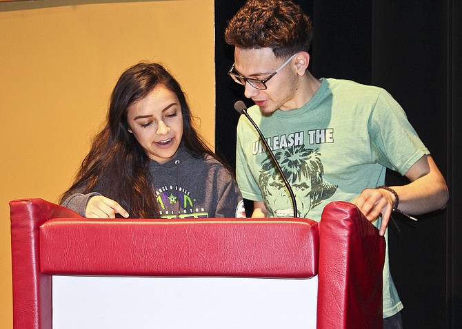 Leadership class members Kimberly Calva and Griffey Sarmiento rehearse their roles as talent show emcees.