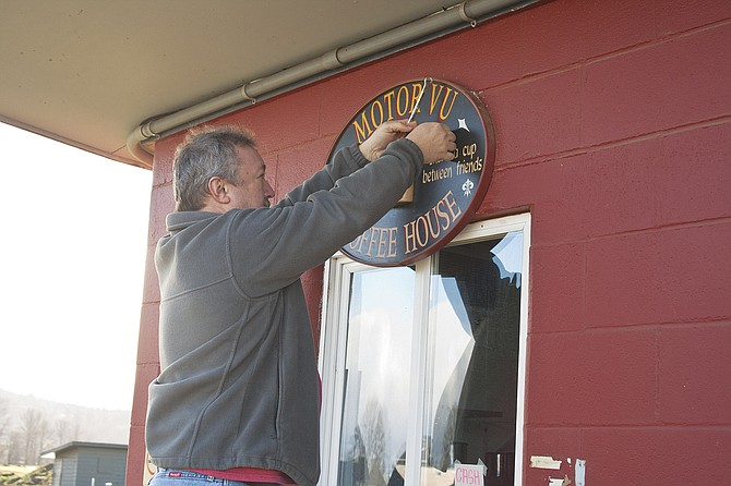 Motor Vu owner Jeff Mexico takes down signage at the snack bar at the drive-in on Friday afternoon.