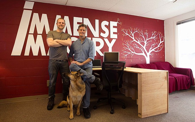 ROB DENNING, Scott Scrimshaw and Sammy pose at the office.
