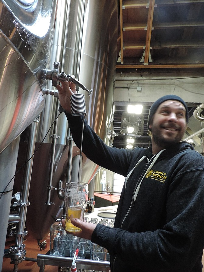 DOUBLE MOUNTAIN's Jon Warzynski pours fresh ale via zwickel at last year's Zwickelmania event.