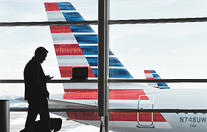 A passenger talks on the phone as American Airlines jets sit parked at their gates at Washington's Ronald Reagan National Airport, above. The American Civil Liberties Union and the Electronic Frontier Foundation say complaints of such searches have spiked recently.