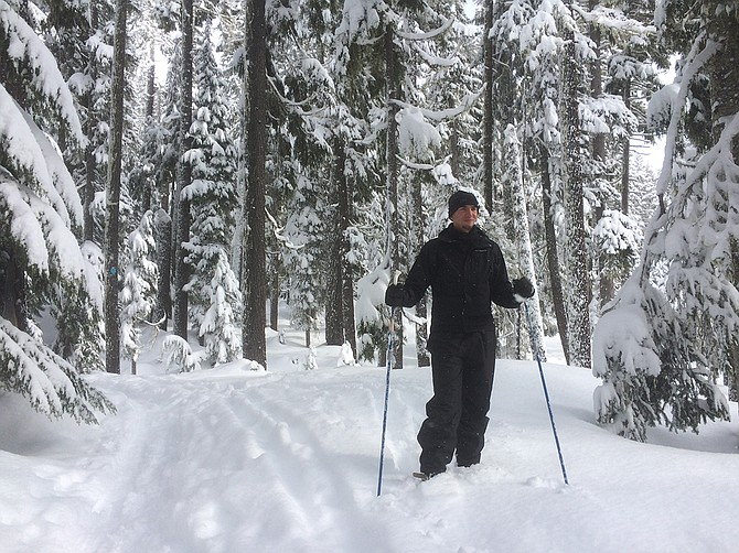 Oregon has many beautiful mountain spots where you can try out your snowshoeing skills. This was taken at Salt Creek Falls on Highway 58 near Odell Lake, about an hour east of Springfield. Below right, Karen Levy travels from Corvallis to Eugene to employ the expertise of Berg's Ski Shop, in adjusting her downhill ski boots. She also loves to snowshoe.