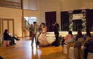 A bride leaves the fashion stage at the 2017 Bridal Show at The Dalles Civic Auditorium Saturday afternoon. Wedding vendors accupied the upstairs ball room. 	Mark B. Gibson photo