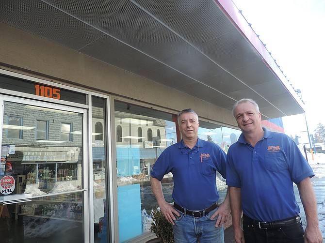 HAY brothers Kevin, left, and Keith Hay stand under the familiar awning on the orange-and-blue façade of E & L Auto on the Heights. With O'Reilly taking over, the signs and the color scheme will change, but for awhile, the Hays will stay involved.