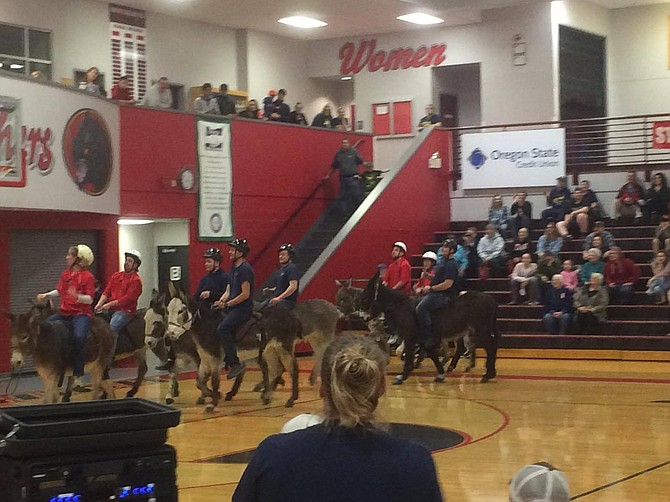 Officers from Monmouth and Independence police departments joined forces with firefighters from Polk Fire No. 1 to take on teams from Polk County employees and the board of commissioners Monday night in donkey basketball, benefiting Central FFA.