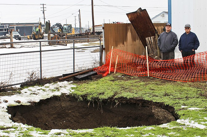 sinkhole that appeared friday in the elder solis backyard near his
