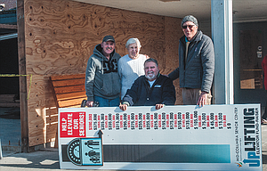 "The ""fundraising thermometer"" at the Mid-Columbia Senior Center is taken down, the $400,000 goal for the project having been met by a $5,000 Griffith Toyota matching grant. Pictured are, left to right, Gary Patton, Joan Silver, Tom Bailey and Executive Director Scott McKay."
